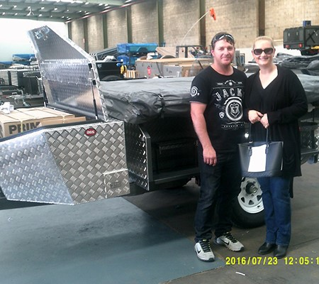 David and Tanija Windon take ownership of their new Mars camper trailer at the company's expanded fa