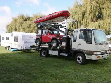Hino hauling a dinghy, wrangler and Roadstar