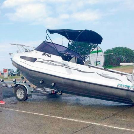 Boat accident resulting from boat coming off a trailer at a boat ramp.