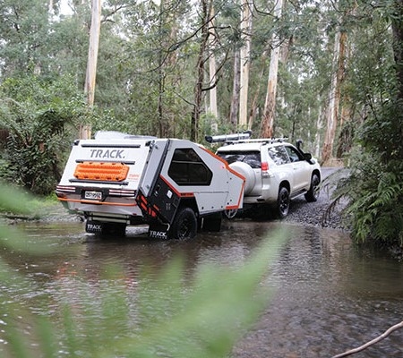 Track Tvan camper trailer crossing the river