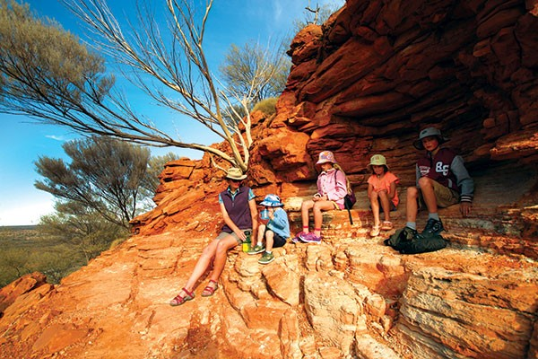Family having a break from hiking at the King's Canyon Rim Walk, NT