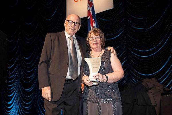 Caravanning Queensland chief executive Ron Chapman was presented his award by Margaret Davis.
