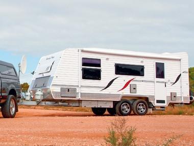 Aussie By Design Humpback Smart Van on the road