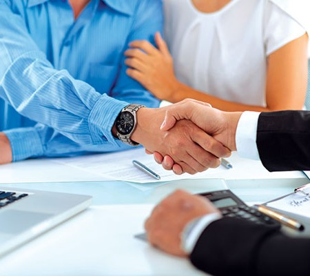 People shaking hands after making a loan application