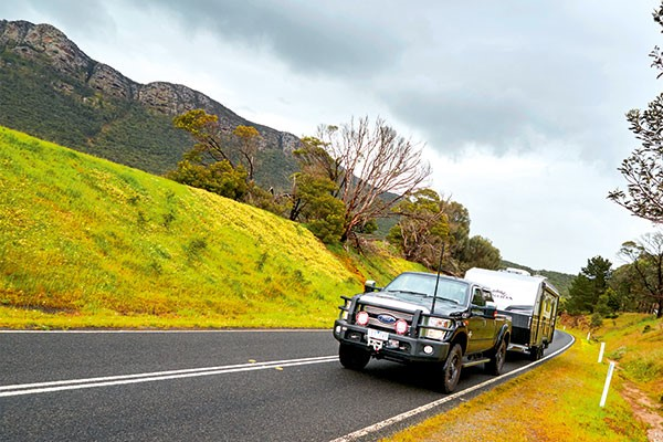 Towing Kokoda caravan on the road