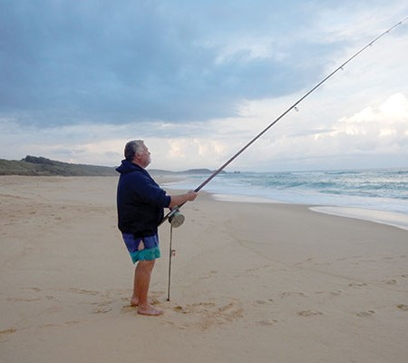 Surf beach fishing at the South Coast NSW during the sunset