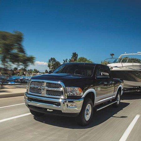 Dodge Ram 2500 Laramie 4x4 Crew-Cab towing large trailerboat