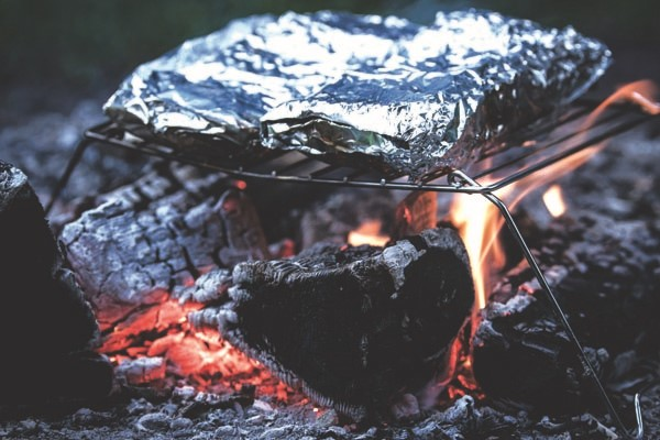 Catch yourself a simple fish dish with bacon and trout cooked in foil.