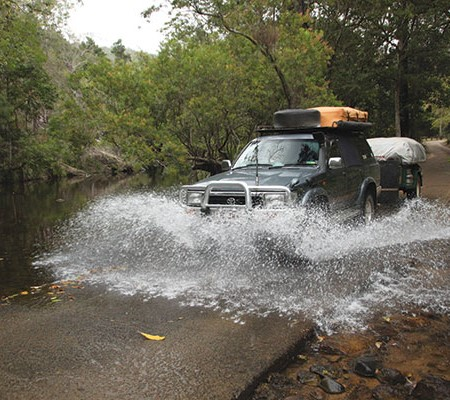 4WD crossing the river at Paluma Range National Park