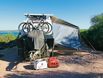 Generators and awnings provide comfort on the road.