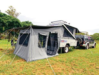 The full awning shades, the tent, and the front of the Brix Z Camper.