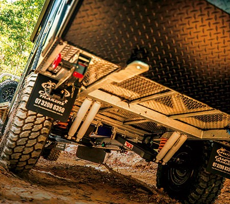 Towing camper trailer offroad in the mud