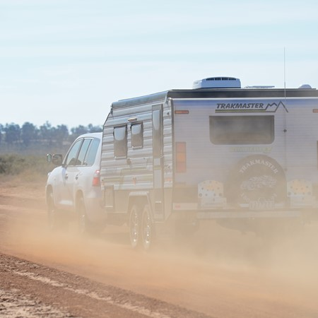 When caravanning on a gravel track, maintain distance between you and the van in front