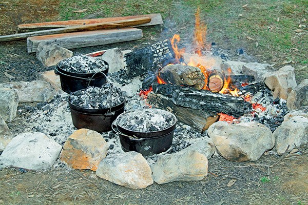 Try slow cooking with just a handful of coals, for fall-off-the-bone soft meat.
