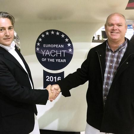 Dr Jens Gerhardt, CEO of HanseYachts AG, congratulates Peter Hrones of Team Windcraft.