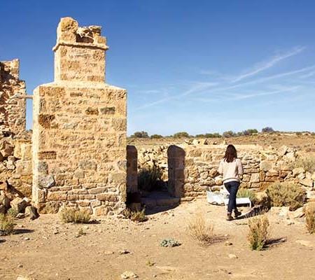 Woman at Strangways Springs ruins walk