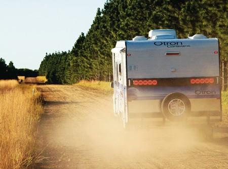 The Otron Caravans Signature Series 3 kicks up dust.
