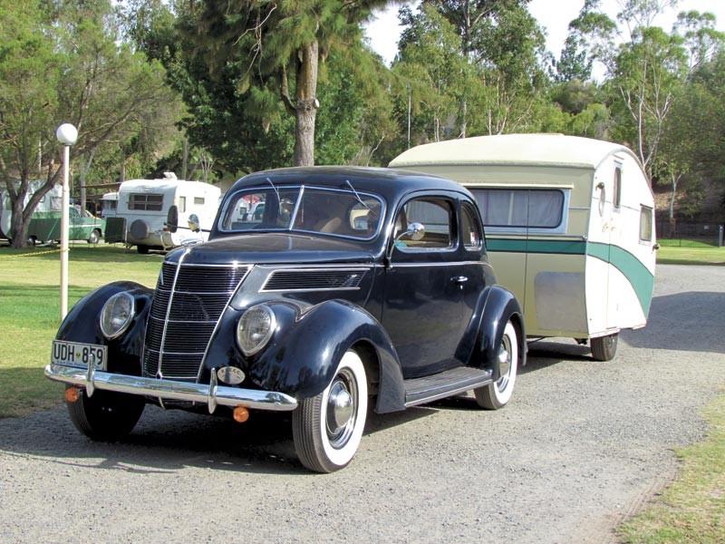 The 1950s Rowvan caravan behind the 1937 Ford.