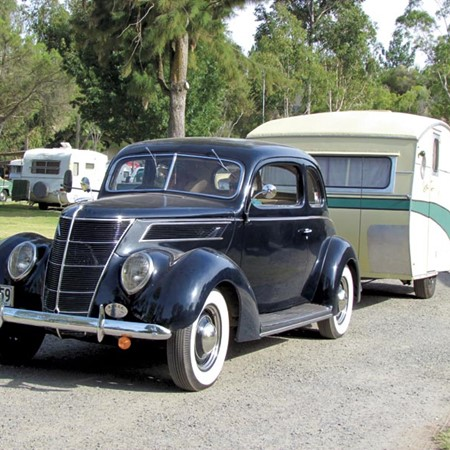 The 1950s Rowvan caravan behind the 1937 Ford.