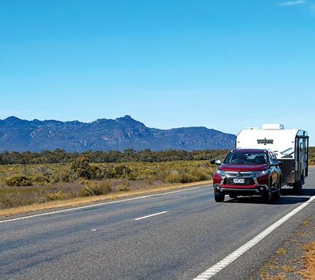 Mitsubishi towing Titan caravan