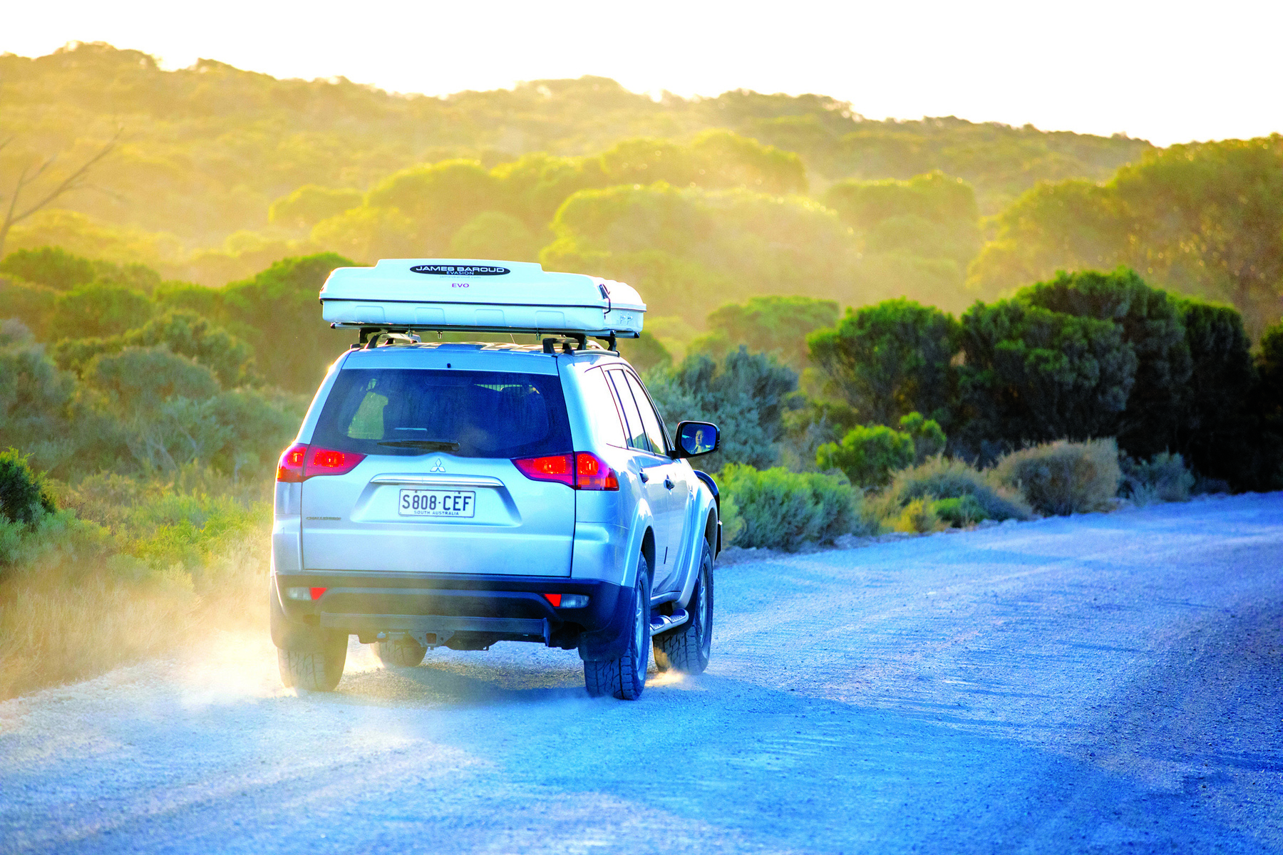 4WD with the james Baroud RTT driving down a dirt road