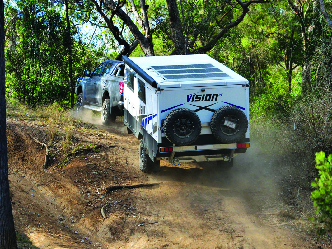 The Vision being towed up a track in the bush