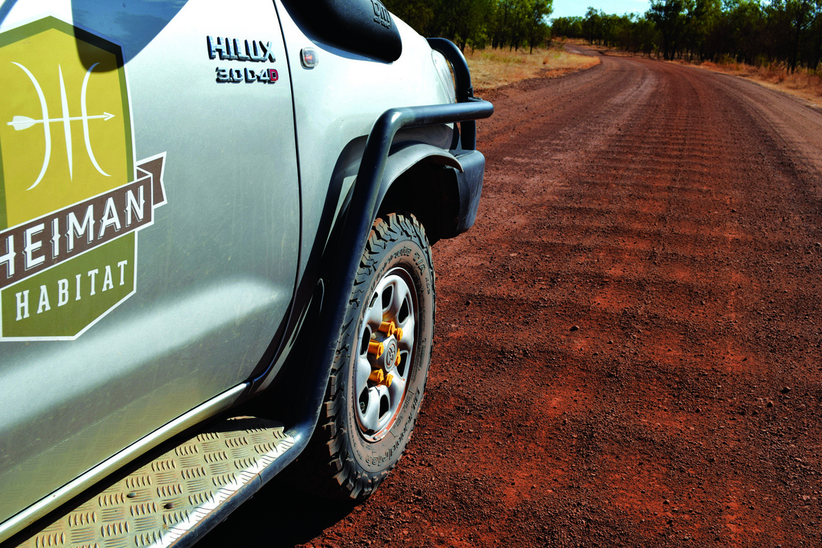 Car driving in red dirt
