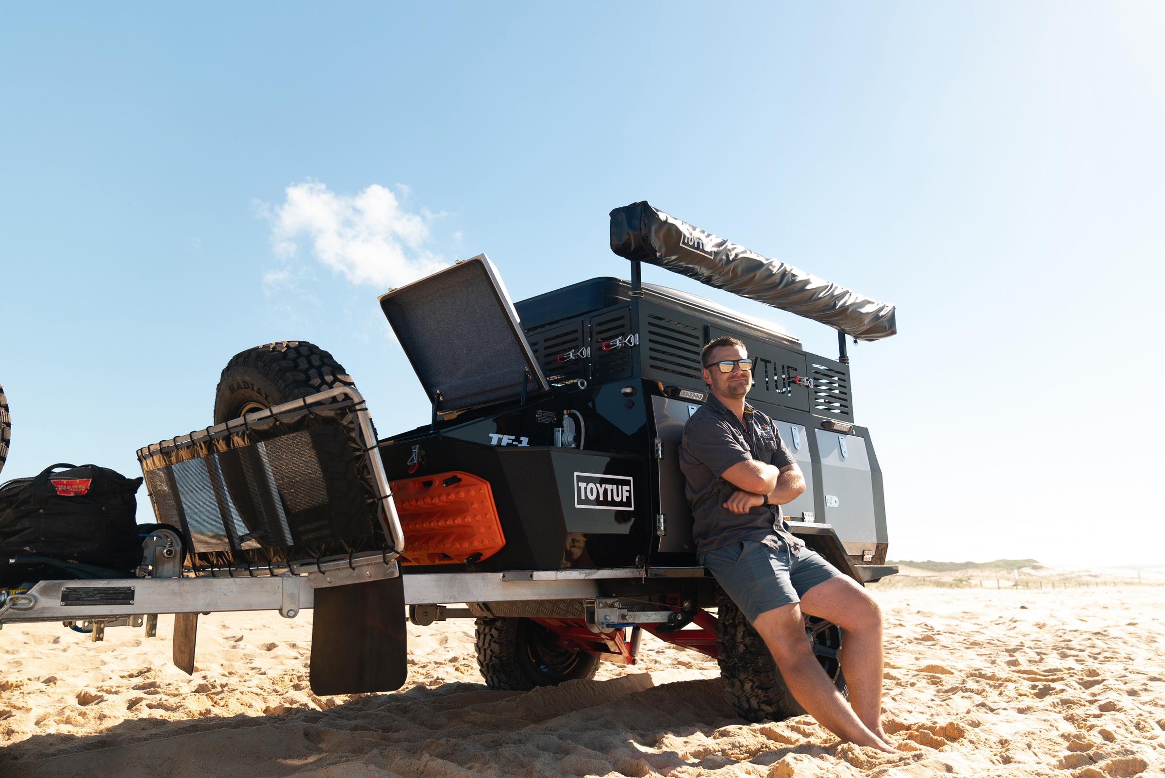 Man leaning on ToyTuf camper trailer