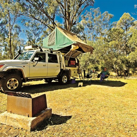 Finding a bit of shade at our serene campsite  in Lake Broadwater Conservation Park